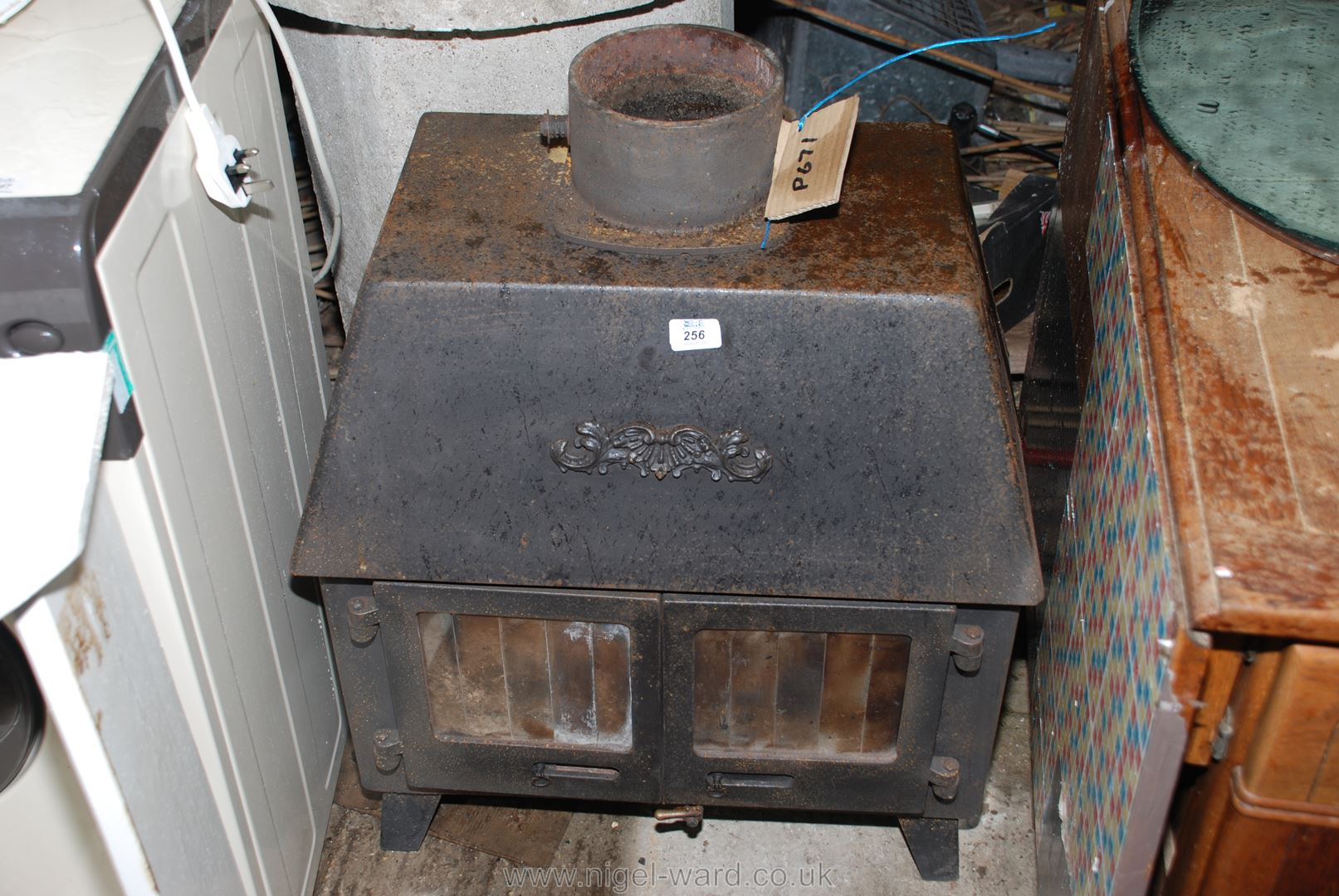 A wood-burner with back boiler.