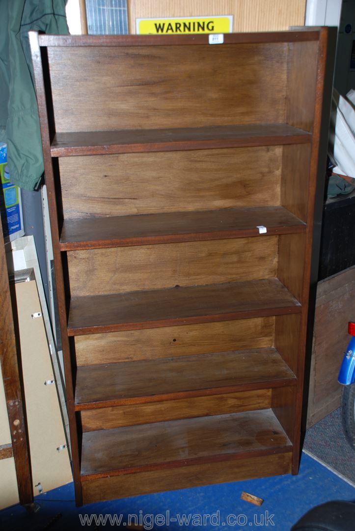 "A dark-wood floor-standing five shelf bookcase/display stand, 32"" x 10"" x 60"" high."