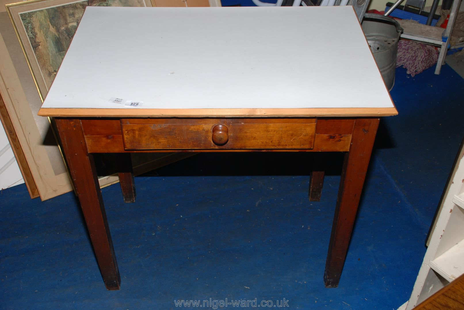 """A white """"Melamine"""" topped desk with a frieze drawer, 31"""" x 21"""" x 29"""" high."""