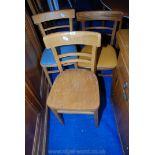 Three similar bent-wood style kitchen chairs.