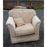 A cream armchair.