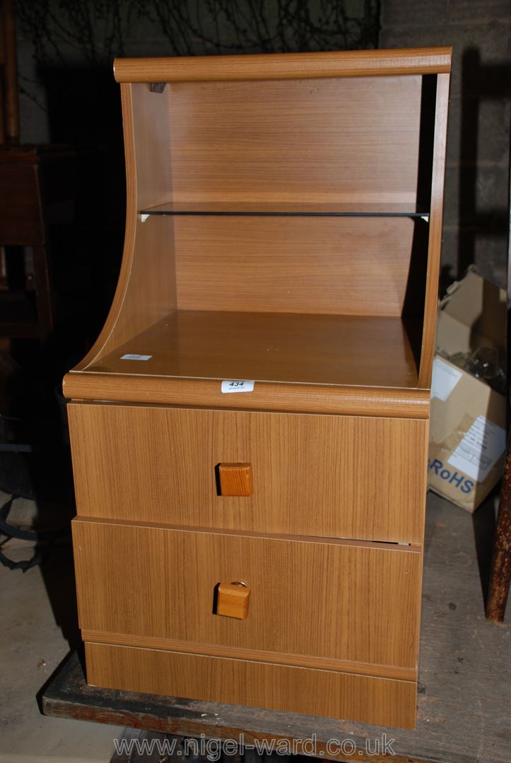 A two-drawer bedside chest with glass shelf.