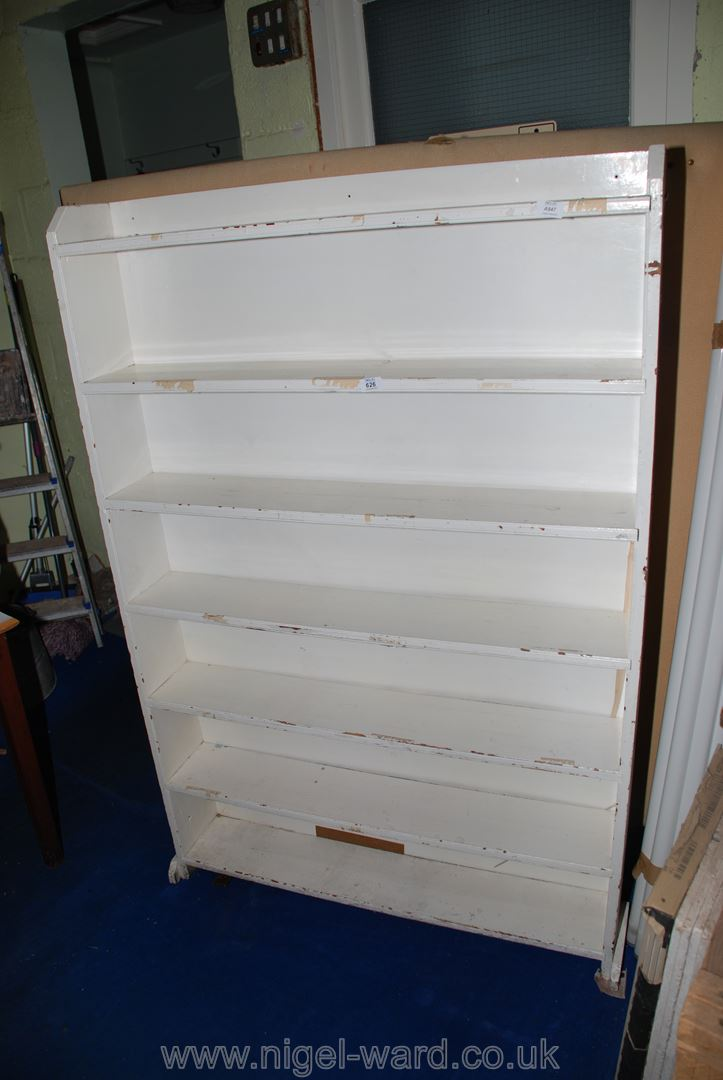 "A seven shelf white painted bookcase, 41"" x 7"" x 62"" high."