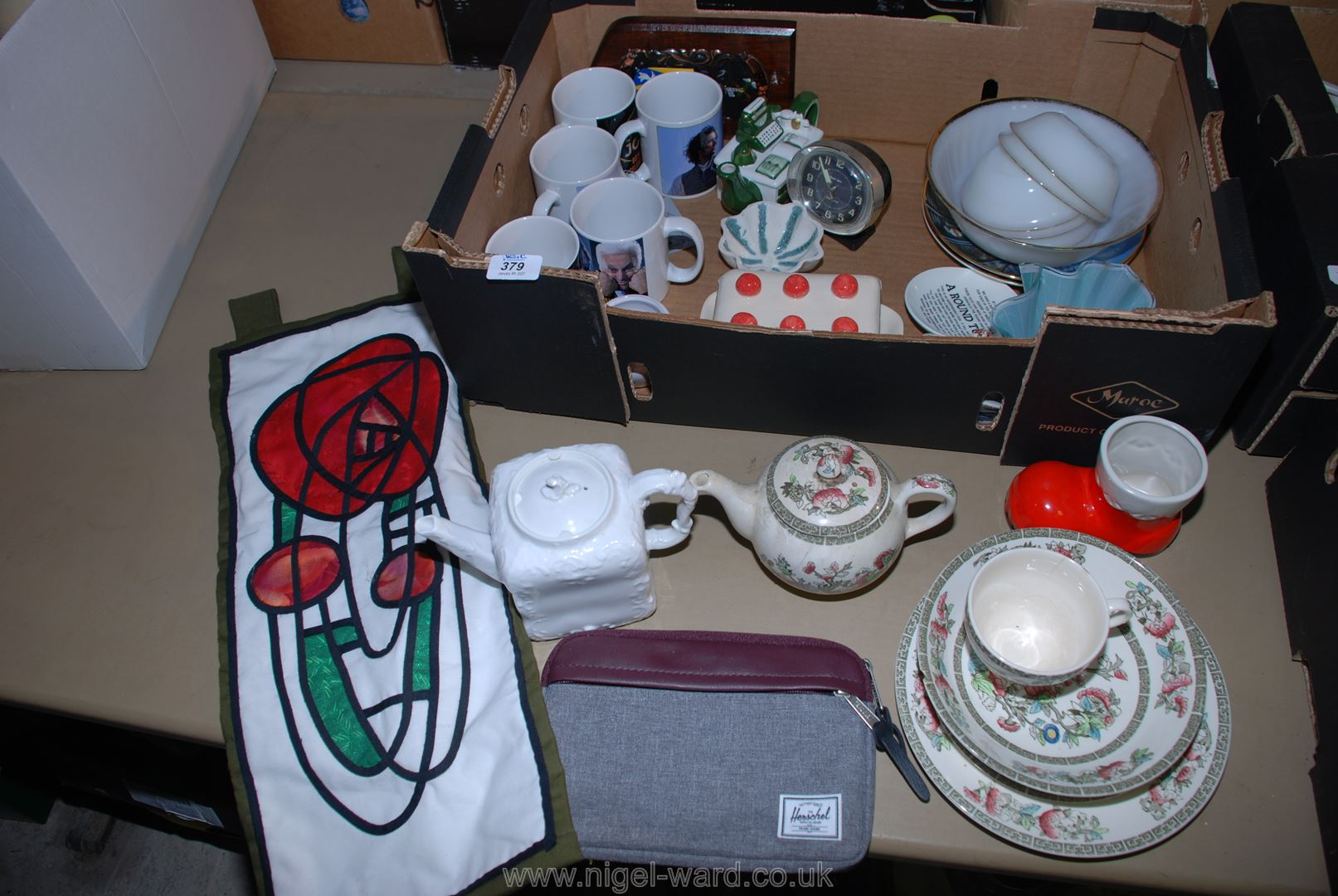 A box of china including Indian Tree, mugs, teapot, etc.