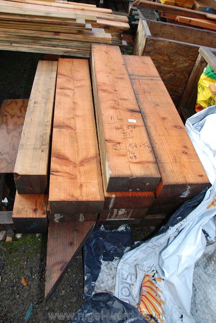 11 lengths of timber 8 1/2'' x 4'' x 51'' long and two lengths 5 1/2'' square x 74'' and 43'' long.
