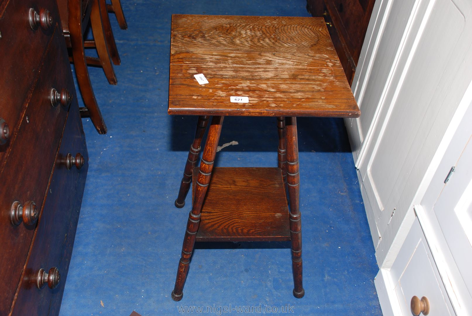 An Oak Arts & Crafts square-topped occasional table, the turned legs united by a lower shelf,