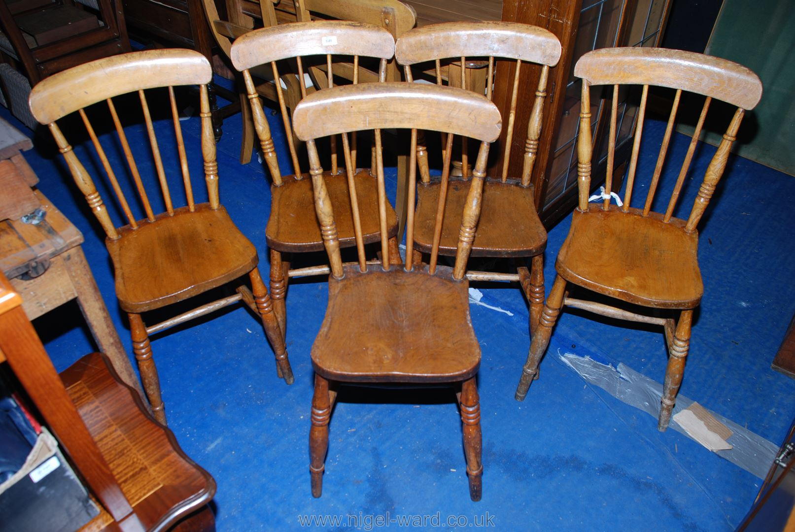 A set of five Elm seated, stick-back kitchen chairs.
