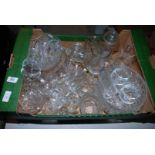 A box of various drinking glasses, glass bowls, etc.