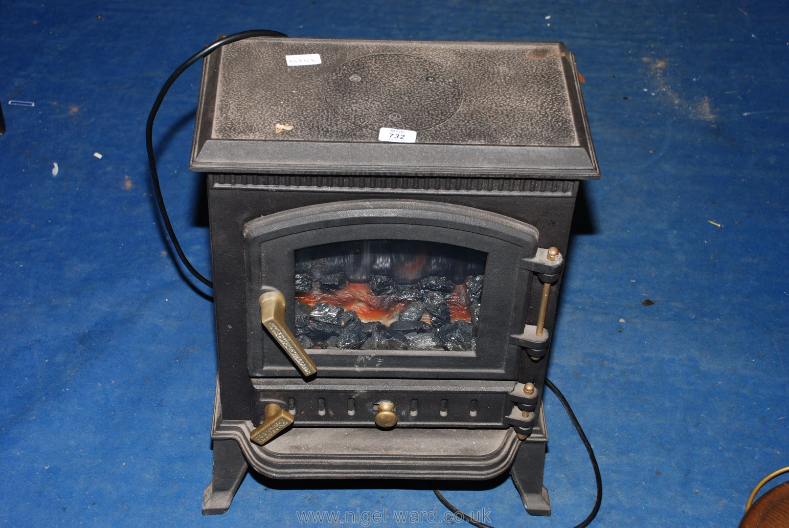 An electric focal-point, wood-stove style fire/heater.