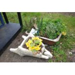 Small planted wheelbarrow and a bowl of herbs