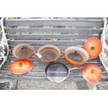 Set of three graduated Le Creuset casserole dishes, lids a/f, plus frying pan.