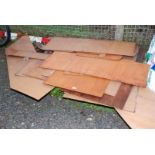 A quantity of various cut off plywood panels.
