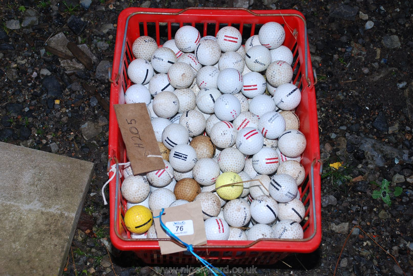 A large basket of used golf balls.