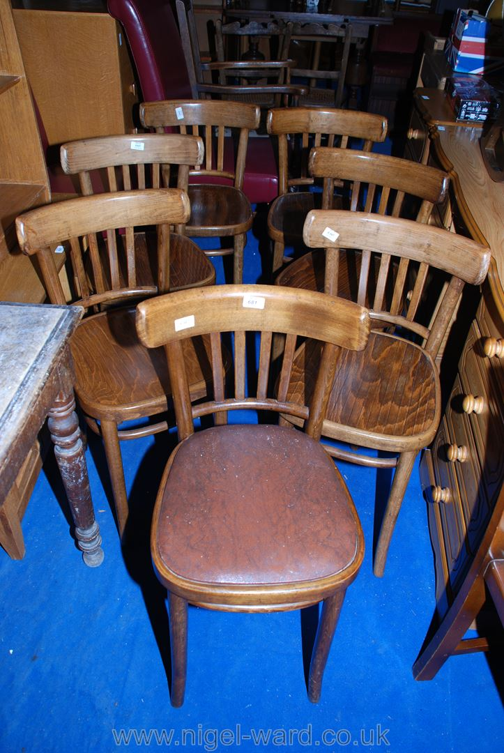 A set of six bent-wood stick-back dining chairs plus one similar.