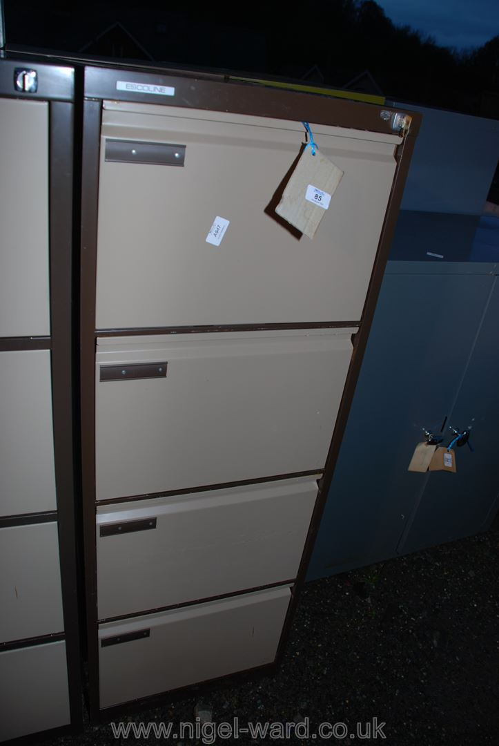 """An Escoline 4 drawer filing cabinet with key. 52"""" high x 24 1/2"""" deep x 19"""" wide."""