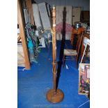A turned wood standard lamp for restoration.