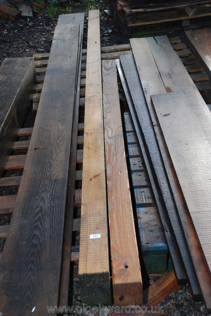 Two lengths of softwood timber at 6'' x 4'' x 135'' and 4'' square x 87''.