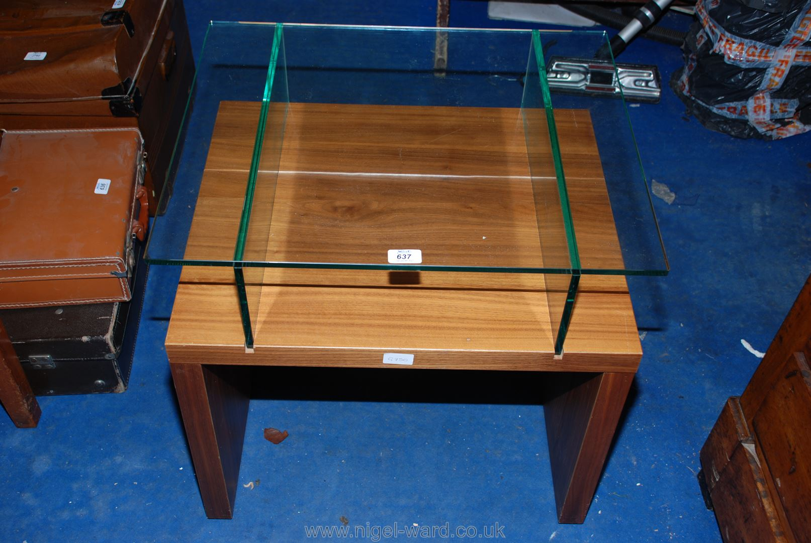"""A stylish glass-topped, wooden-based TV stand 24"""" x 24"""" x 20""""."""