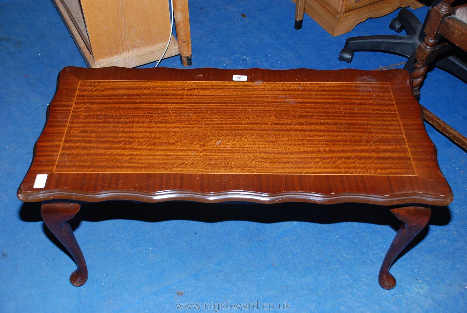 "A scalloped-edged modern Mahogany coffee table 38"" x 18""."