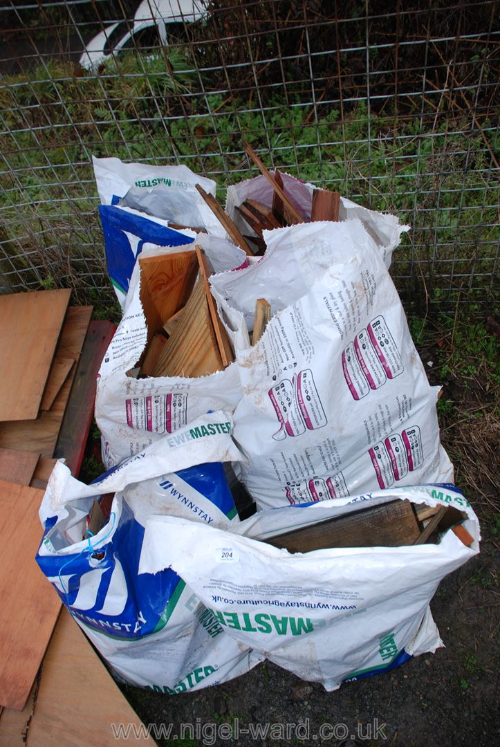 Six bags of softwood off cuts for firewood.