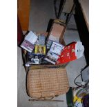 A wicker basket and a large quantity of unopened classical C.D.'s, etc.