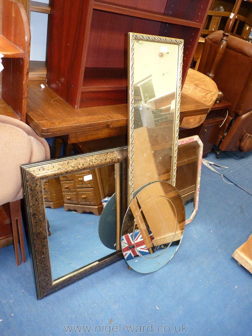 A gilt framed mirror; 46'' x 13 1/2'', plus three others.