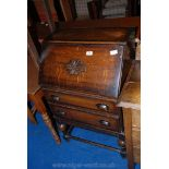 A small dark Oak bureau,