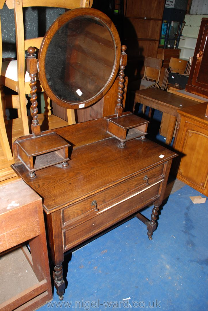"""A two drawer dressing table with circular mirror, 3' x 18"""" x 62"""" high."""