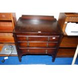 """A dark Oak finished three-drawer chest of drawers, 29"""" x 18"""" x 32"""" high."""