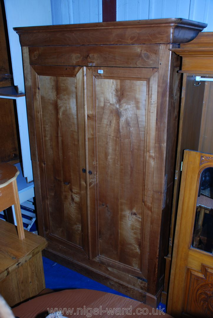 "A large hardwood two-door wardrobe, probably Cherry/Satin-wood, 52"" x 21"" x 86"" high."