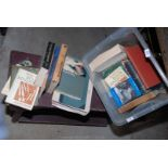 A large quantity of books on book-binding and equipment in a wicker basket.
