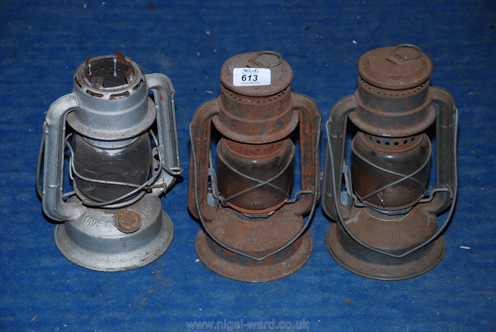 Three paraffin storm lanterns/hurricane lamps.