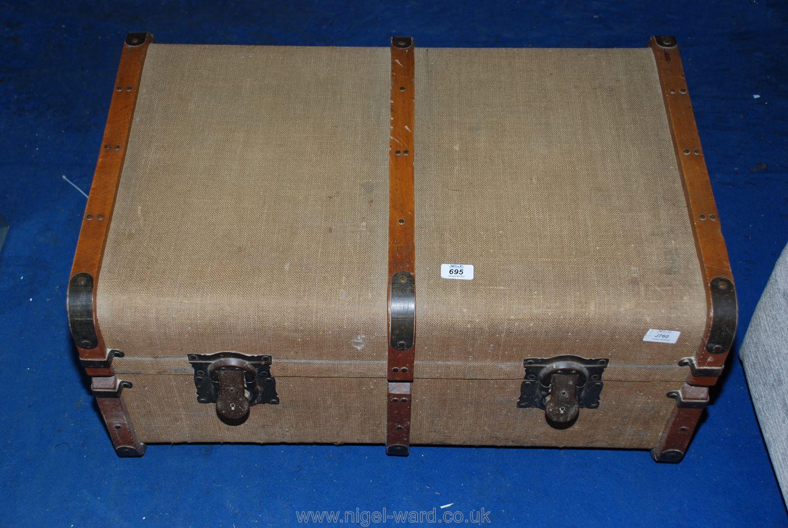 A bent-wood bound travel trunk.