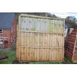 Four fence panels 6' square and a shed floor 7' x 5'.