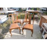 Set of four splat back dining chairs