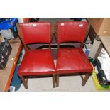 Two leatherette and wooden dining chairs.
