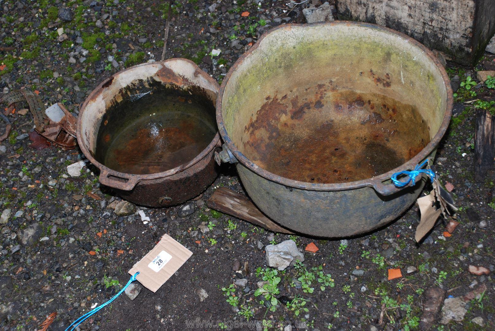 Two cast pots