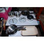 """A red """"Le Creuset"""" casserole dish, set of five """"Swan"""" saucepans, a milk pan, etc."""