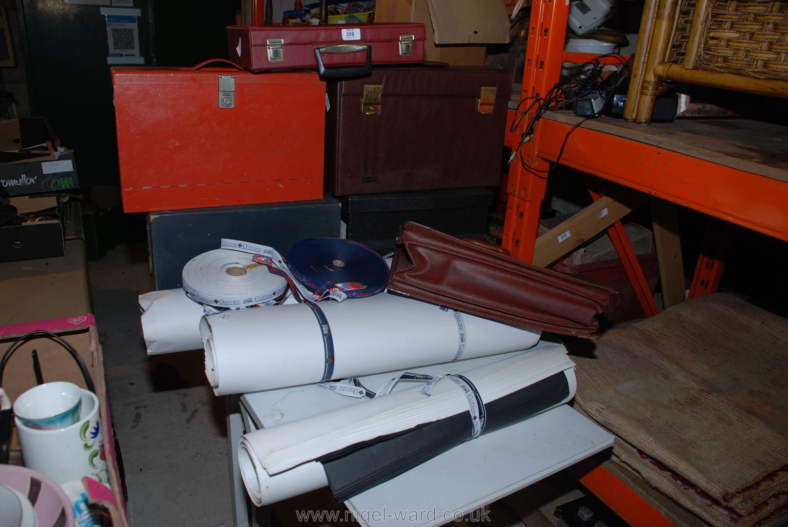 A quantity of filing boxes, rolls of paper, card, fabric, tape, etc.