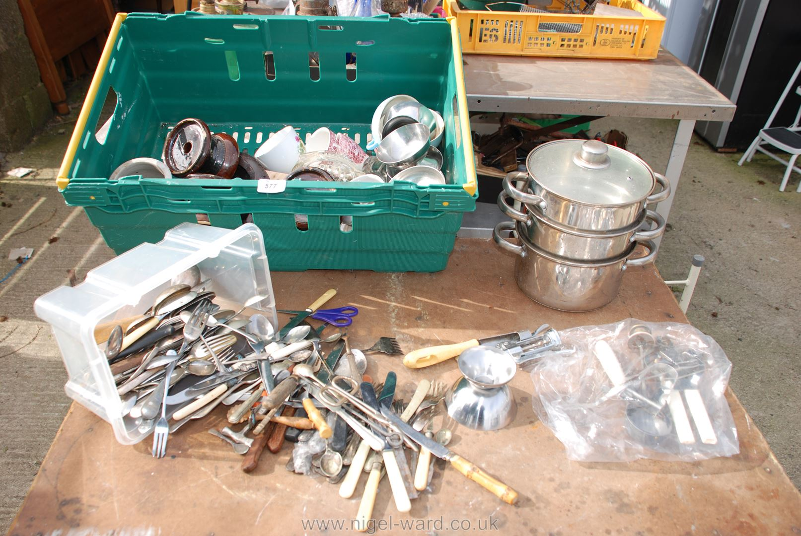 Tray of steaming pans, sundae dishes, cutlery etc.