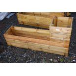 Two tier garden planter 47 1/2'' long x 12'' wide x 11'' high, highest part 23''.