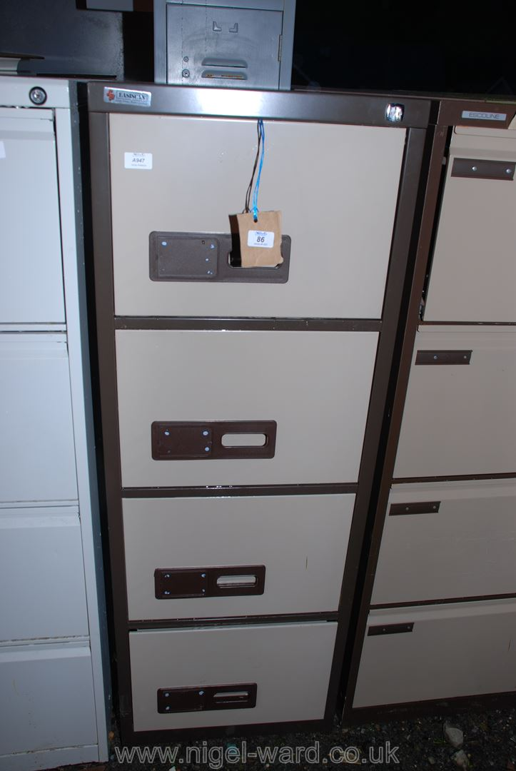 "An Easiscan 4 drawer filing cabinet with key. 52"" high x 24 1/2"" deep x 19"" wide."