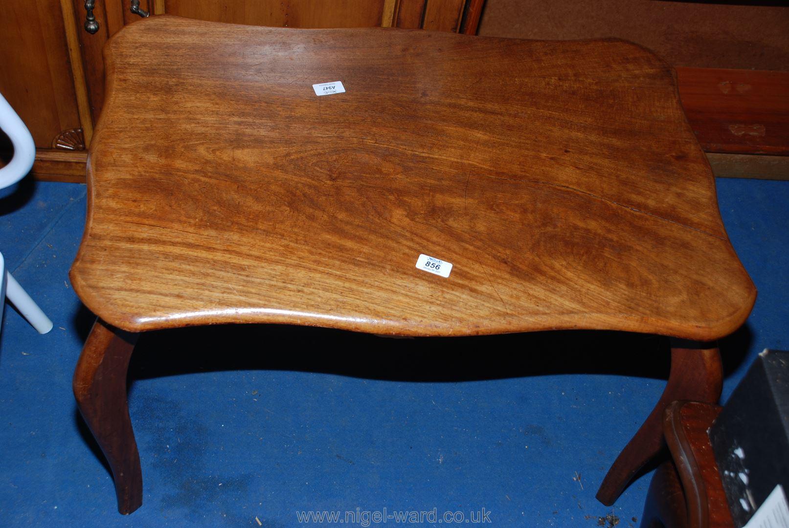 "A hardwood coffee table apx 34"" x 21"" (inc leg width) x 19"" high."