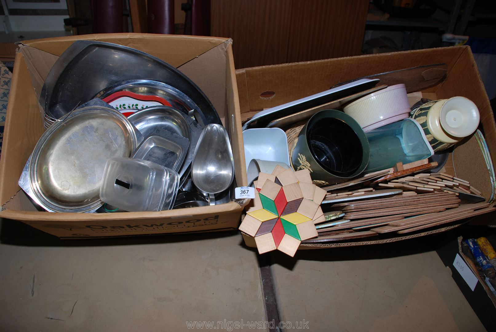 Miscellaneous stainless steel dishes and kitchenware plus various table mats, etc.
