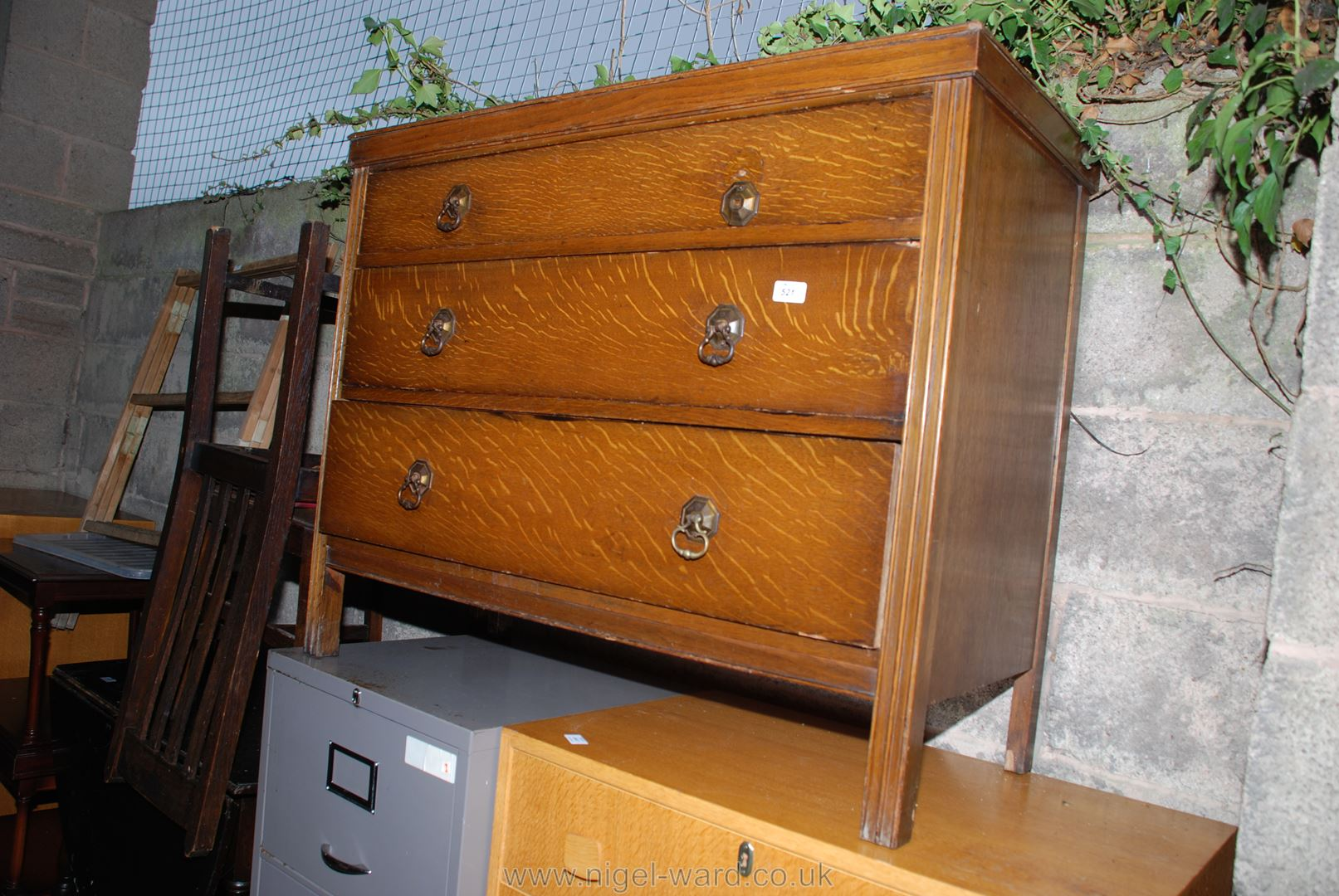 A three-drawer bedroom chest.