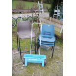 Garden spreader, three stacking chairs and high stool.