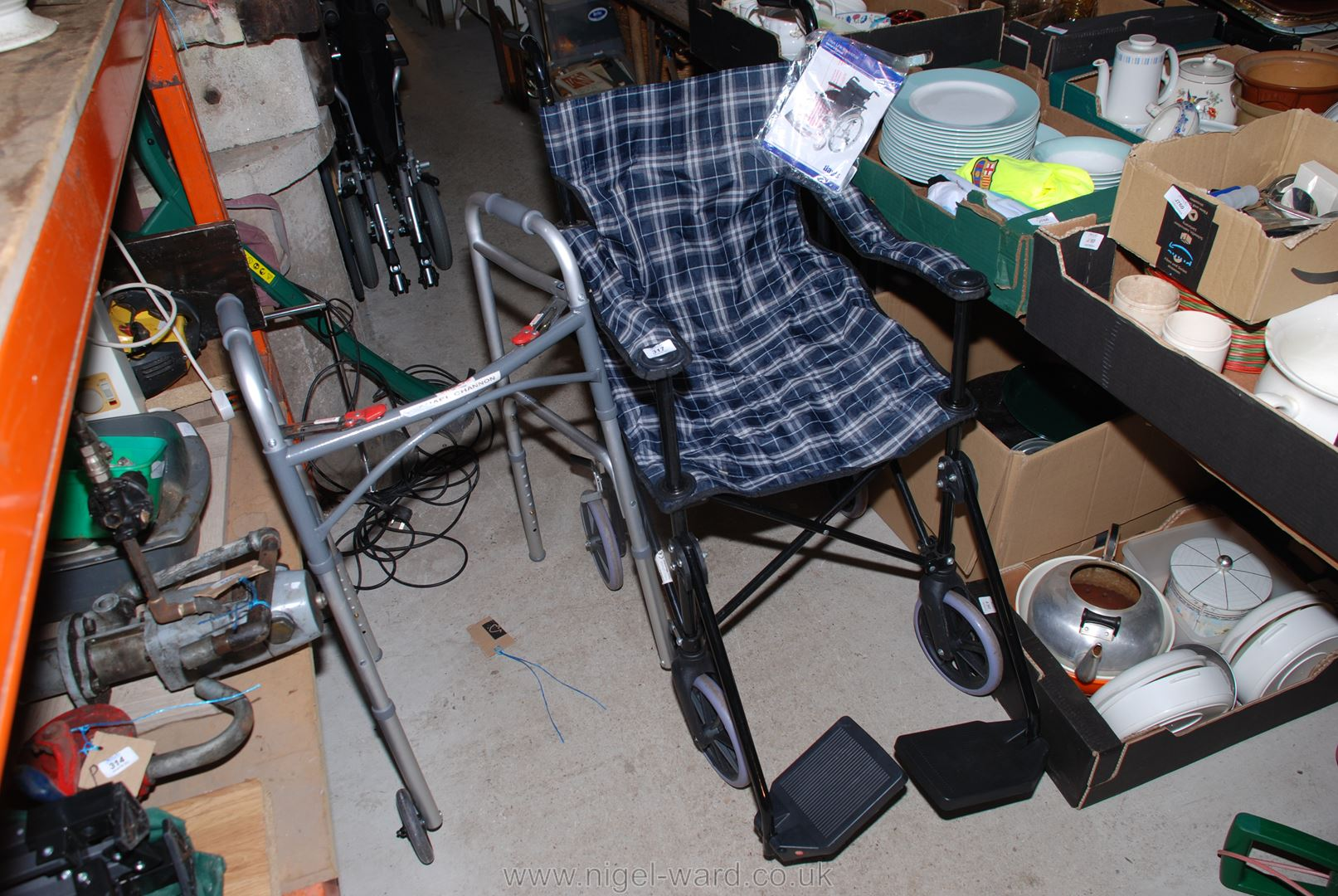 A Days Link wheelchair and a folding walking aid.