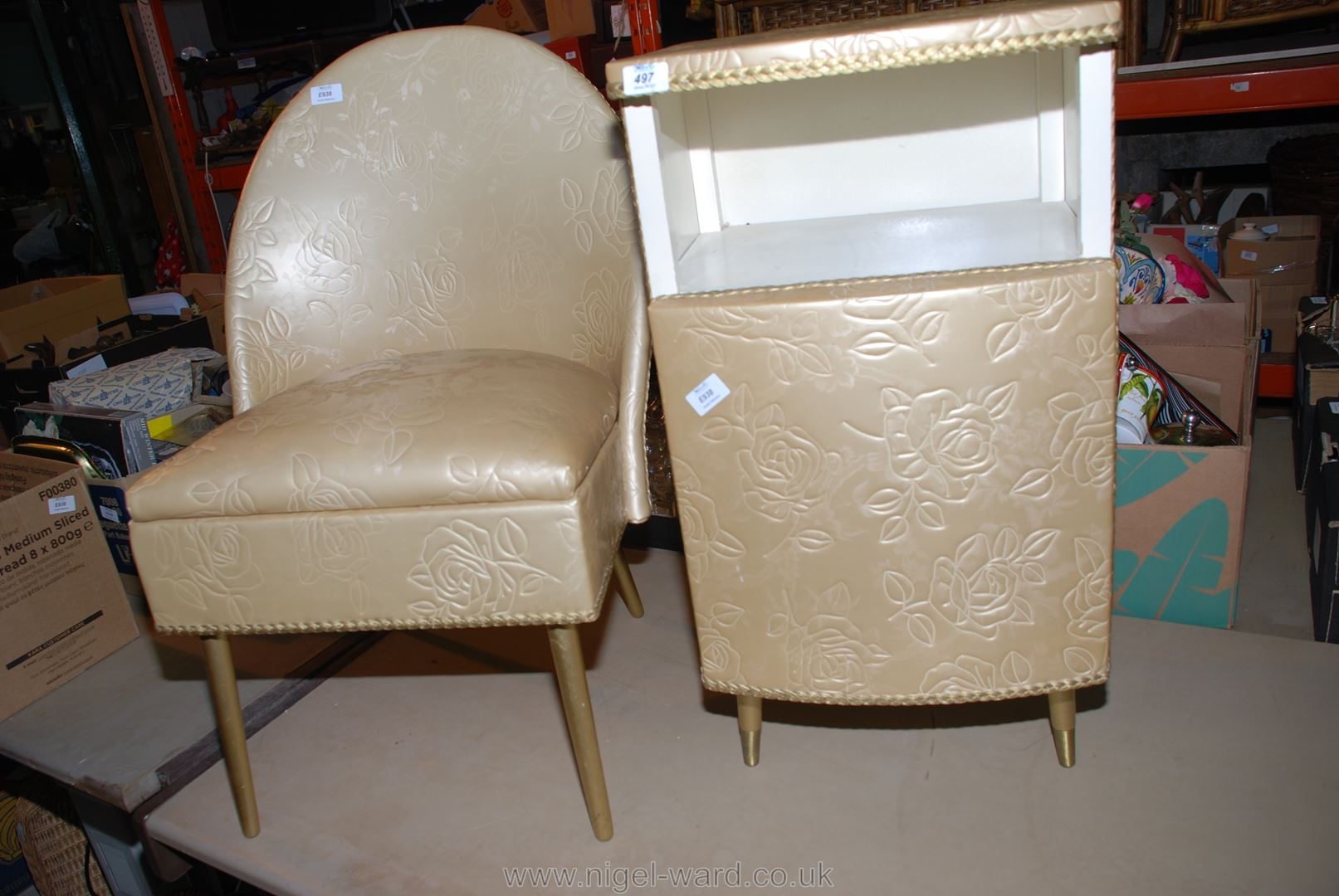 A bedroom chair and a bedside cabinet.