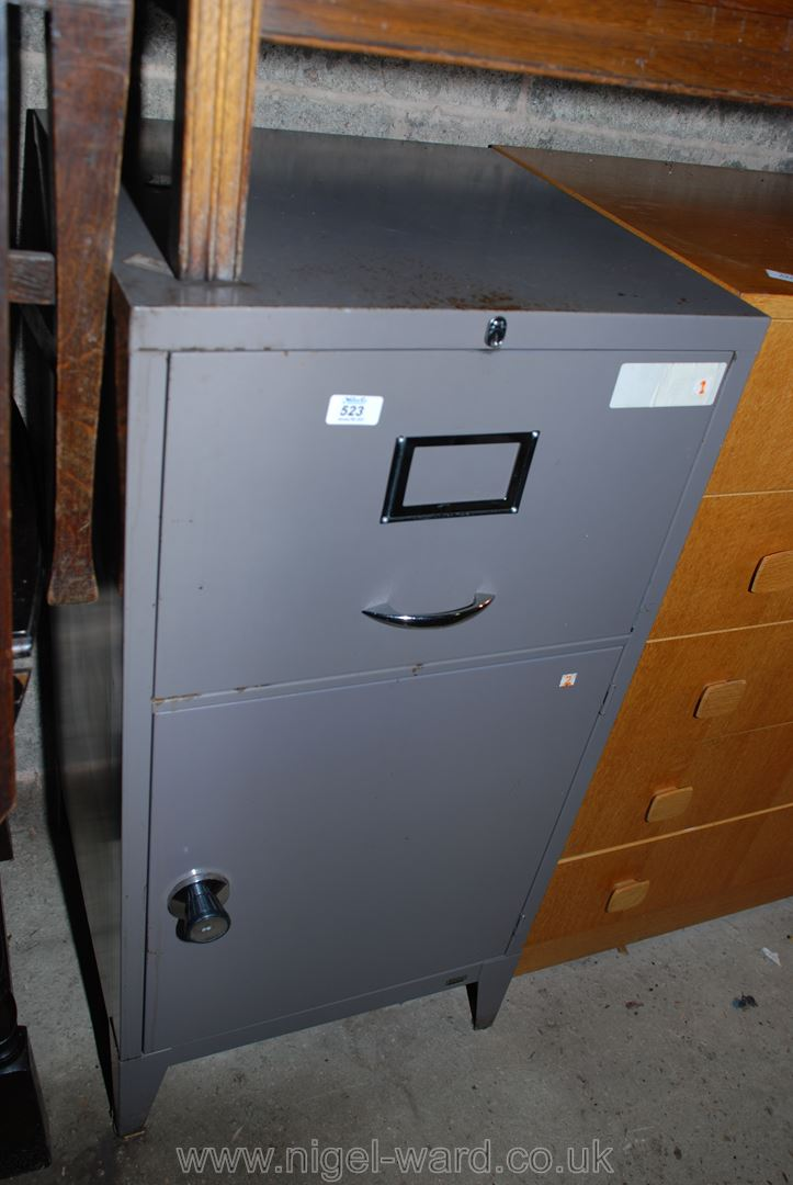 """A metal filing cabinet with cupboard to base, 19"""" x 19"""" deep x 39"""" high."""
