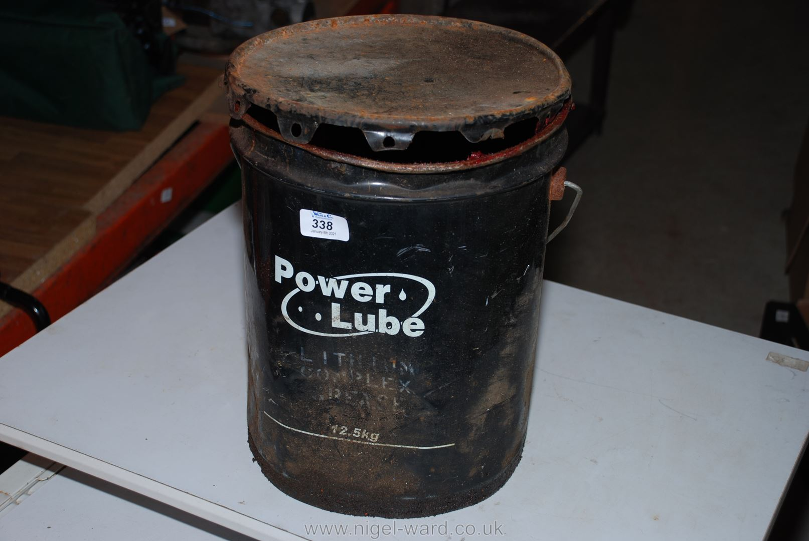 "A tub of ""Powerlube"" grease."